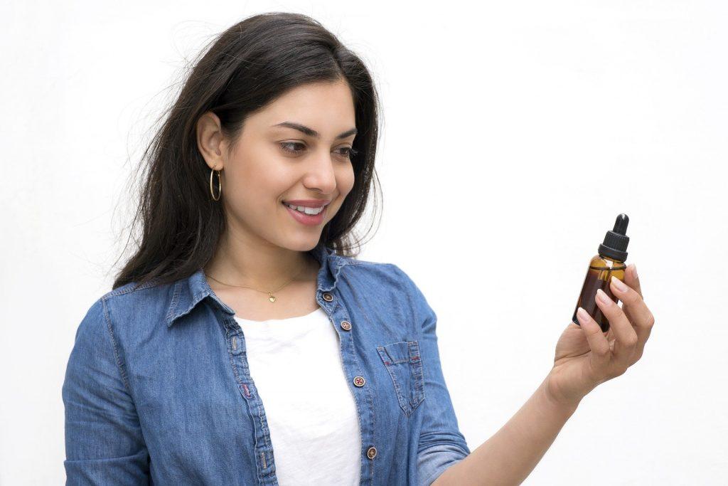 woman looking at cbd oil